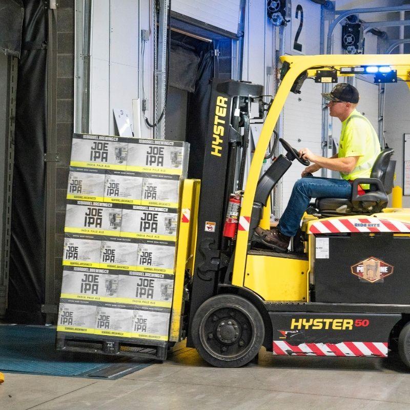 Forklift lifting pallets