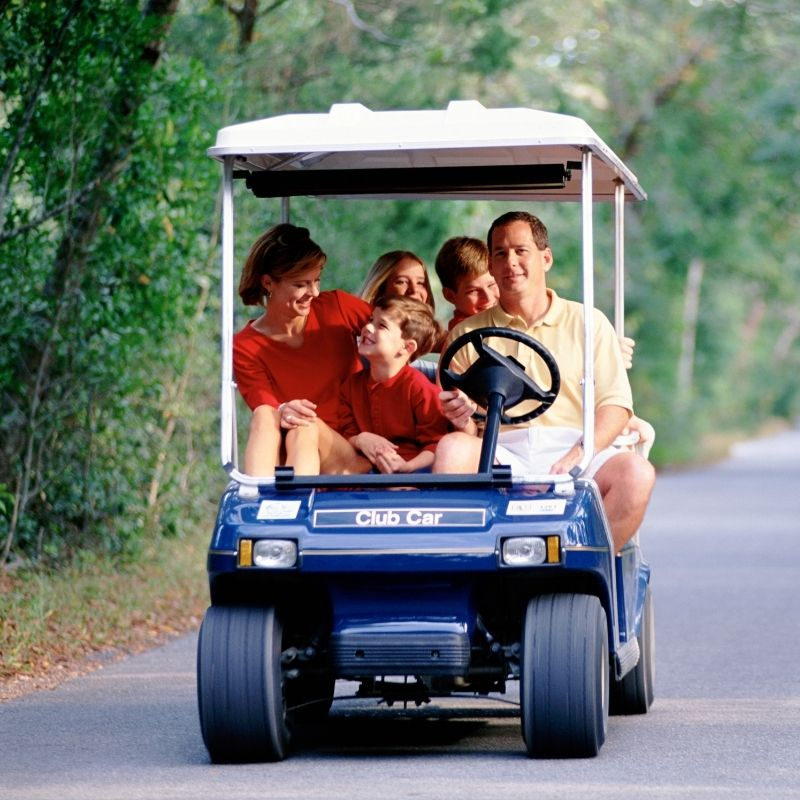 Family on golf cart