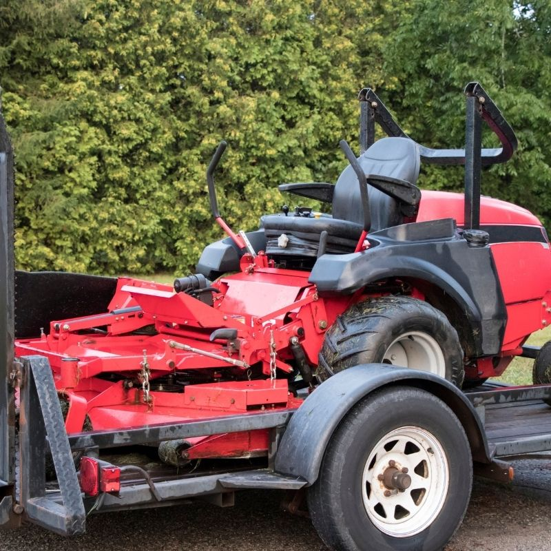 Riding lawn mower on trailer
