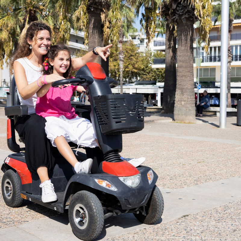 Mother and child on mobility scooter