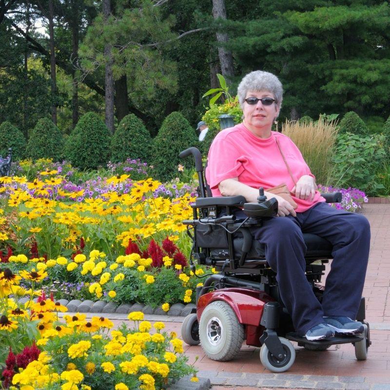 Women in motorized wheelchair