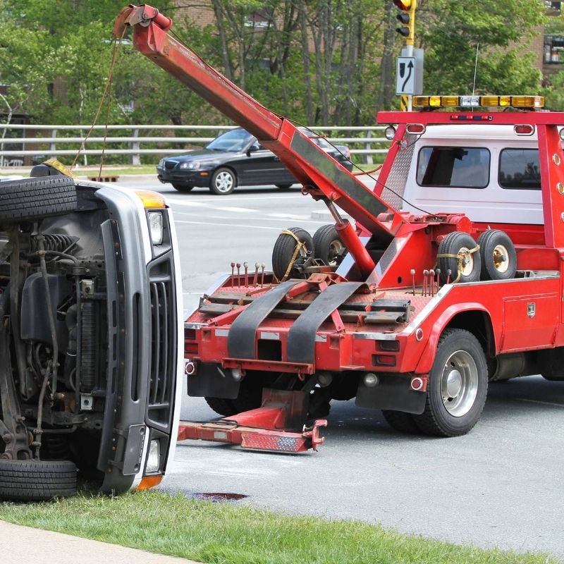 Tow truck assisting at accident
